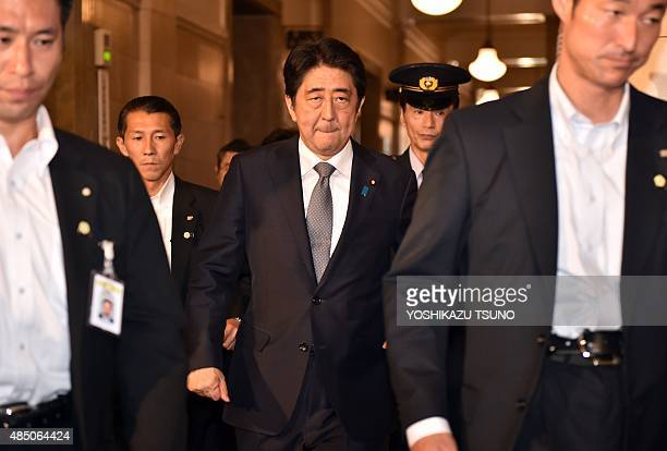 Japanese Prime Minister Shinzo Abe arrives at the Upper House's budget committee session at the National Diet in Tokyo on August 24 2015 Abe will not...