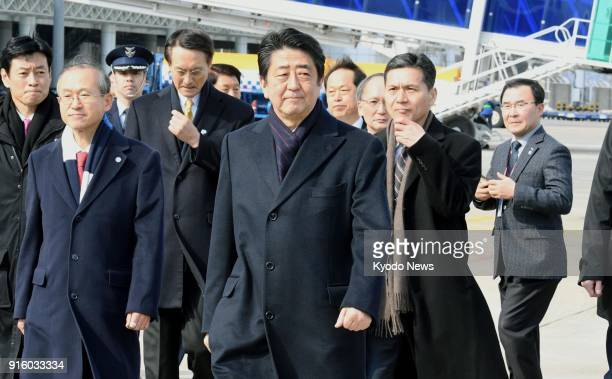 Japanese Prime Minister Shinzo Abe arrives at Yangyang airport in South Korea on Feb 9 prior to the opening ceremony of the Pyeongchang Winter...