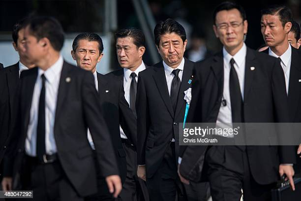 Japanese Prime Minister Shinzo Abe arrives for the 70th anniversary ceremony of the atomic bombing of Hiroshima at the Hiroshima Peace Memorial Park...