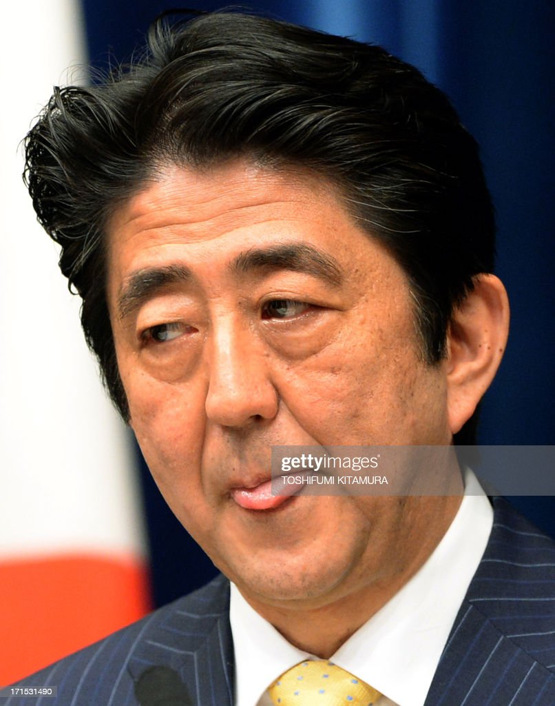 Japanese Prime Minister Shinzo Abe at a press conference at his official residence in Tokyo on June 26, 2013. Abe said he will spend the next three years rebuilding the nation's fragile economy, the foundation of Tokyo's global standing.