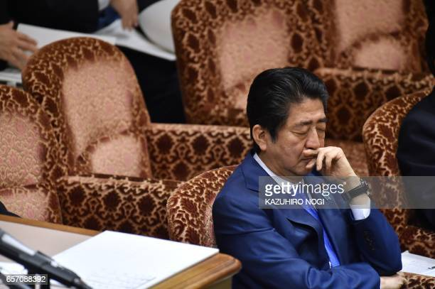 Japanese Prime Minister Shinzo Abe attends a budget committee session of the House of Councilors at the Parliament in Tokyo on March 24 2017 A...