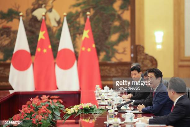 Japanese Prime Minister Shinzo Abe attends a meeting with Chinese Premier Li Keqiang inside the Great Hall of the People in Beijing on October 26...