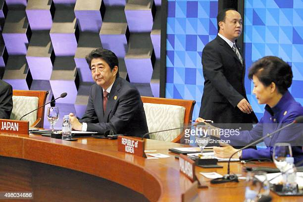 Japanese Prime Minister Shinzo Abe attends a plenary session of the Asia Pacific Economic Cooperation on November 19, 2015 in Manila, Philippines....