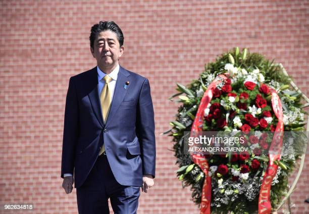 Japanese Prime Minister Shinzo Abe attends a wreath laying ceremony at the Tomb of the Unknown Soldier in Moscow on May 26 2018