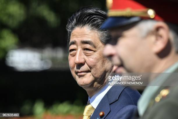 Japanese Prime Minister Shinzo Abe attends a wreath laying ceremony at the Tomb of the Unknown Soldier in Moscow on May 26, 2018.