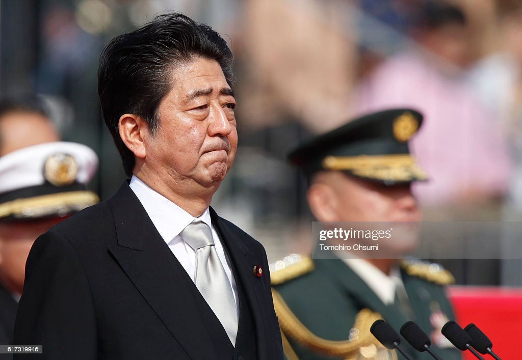Japanese Prime Minister Shinzo Abe attends the annual review of the Self Defense Forces at the Japan Ground Self-Defense Force Camp Asaka on October 23, 2016 in Asaka, Japan.