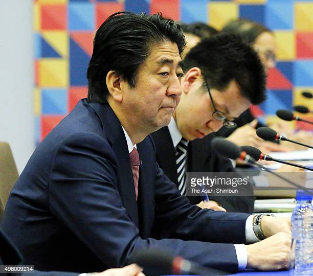 Japanese Prime Minister Shinzo Abe attends the bilateral meeting with Philippines President Benigno Aquino III on the sidelines of the Asia Pacific...