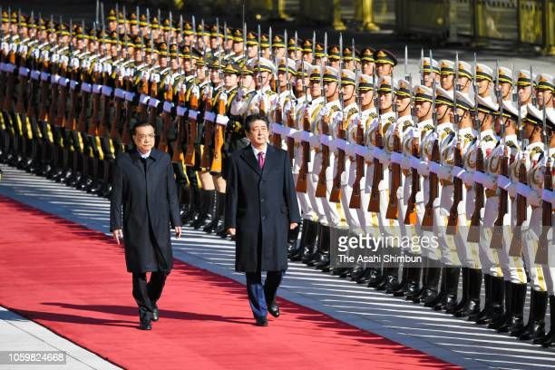 Japanese Prime Minister Shinzo Abe attends the welcome ceremony with Chinese Premier Li Keqiang at the Great Hall of the People on October 26, 2018...
