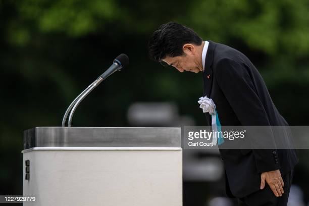 Japanese Prime Minister Shinzo Abe bows after making a speech during the 75th anniversary of the Hiroshima atomic bombing on August 6 2020 in...