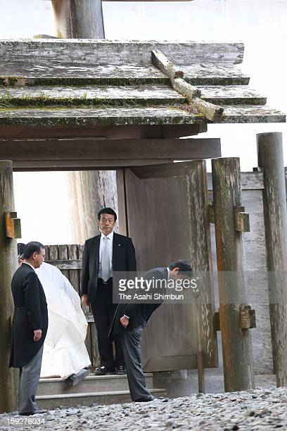 Japanese Prime Minister Shinzo Abe bows during his visit to Ise Jingu Shrine on Janaury 4, 2013 in Ise, Mie, Japan.