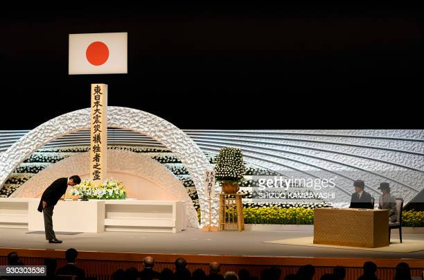 TOPSHOT Japanese Prime Minister Shinzo Abe bows to Prince Akishino and Princess Kiko during the seventh national memorial service for victims of the...