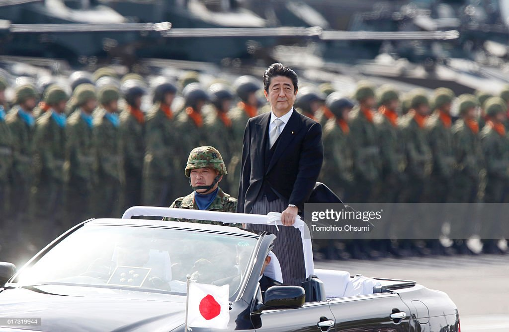 Japanese Prime Minister Shinzo Abe, center right, inspects troops of the Self Defense Forces during the annual review at the Japan Ground Self-Defense Force Camp Asaka on October 23, 2016 in Asaka, Japan.