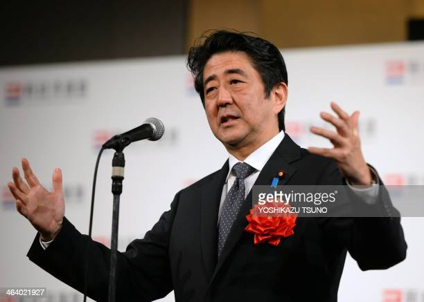 Japanese Prime Minister Shinzo Abe delivers a speech at a New Year party of a business group Japan Association of New Economy led by Hiroshi Mikitani...