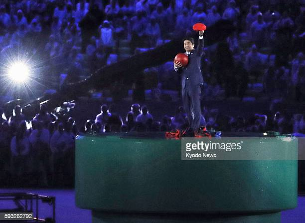 Japanese Prime Minister Shinzo Abe dressed up as Super Mario makes an appearance during the closing ceremony of the Rio de Janeiro Olympics on Aug 21...