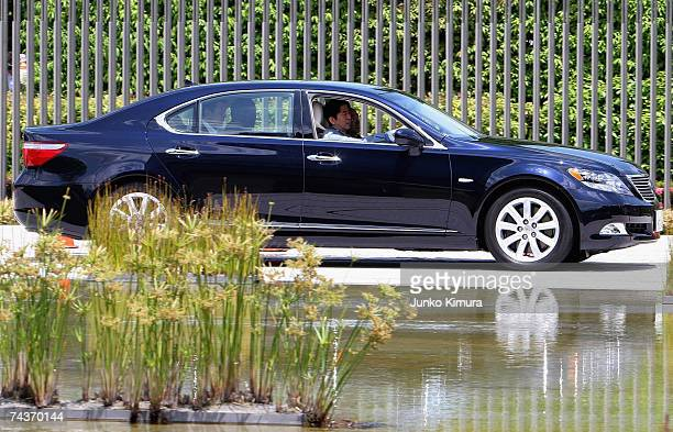 Japanese Prime Minister Shinzo Abe drives one of Toyota Motor Corporation's hybrid cars the Lexus LS600hL at the Prime Minister's official residence...