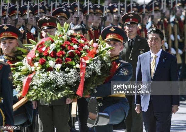 Japanese Prime Minister Shinzo Abe follows a wreath during a ceremony at the Tomb of the Unknown Soldier on May 26 2018 in Moscow