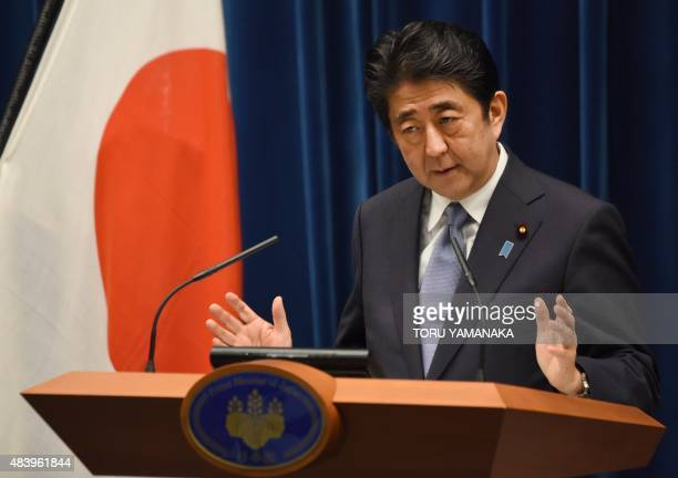 Japanese Prime Minister Shinzo Abe gestures as he answers questions following his war anniversary statement that neighbouring nations will scrutinise...