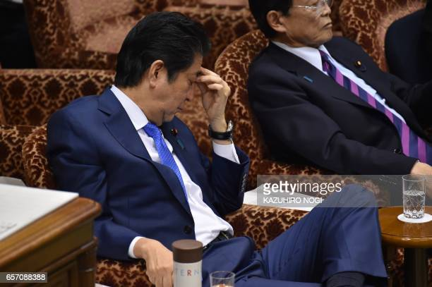 Japanese Prime Minister Shinzo Abe gestures as he attends a budget committee session of the House of Councilors at the Parliament in Tokyo on March...