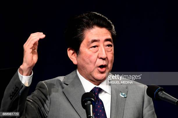 Japanese Prime Minister Shinzo Abe gives a press conference at the end of a G7 summit of Heads of State and of Government on May 27 2017 in Taormina...