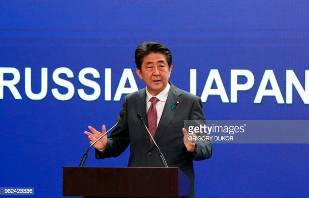 Japanese Prime Minister Shinzo Abe gives a speech at a session of the Saint Petersburg International Economic Forum on May 25 2018 in Saint Petersburg