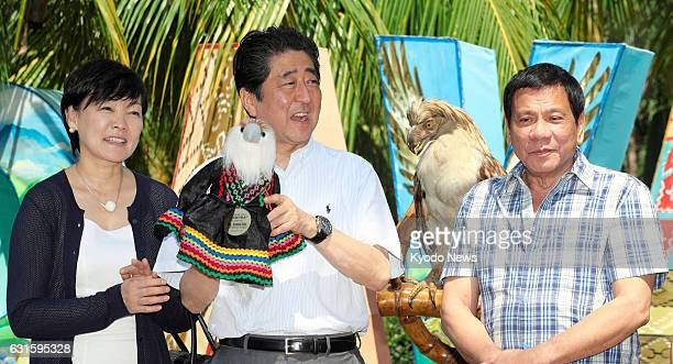 Japanese Prime Minister Shinzo Abe his wife Akie and Philippine President Rodrigo Duterte attend a ceremony to name a critically endangered...