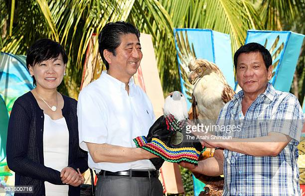 Japanese Prime Minister Shinzo Abe his wife Akie and Philippines President Rodrigo Duterte attend a naming ceremony of a Philippine eagle on January...
