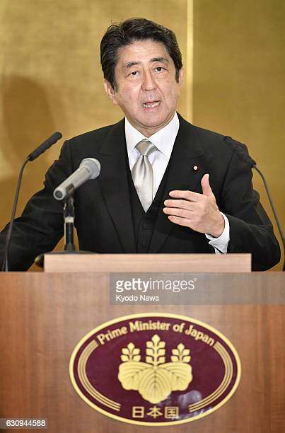Japanese Prime Minister Shinzo Abe holds a New Year press conference in the central Japan city of Ise on Jan. 4 after visiting the Ise Grand Shrine...