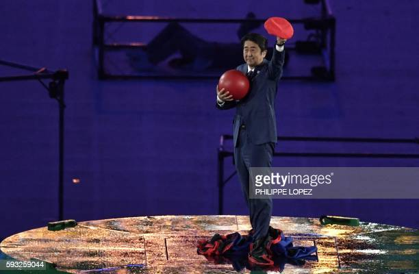 TOPSHOT Japanese Prime Minister Shinzo Abe holds a red ball during the closing ceremony of the Rio 2016 Olympic Games at the Maracana stadium in Rio...