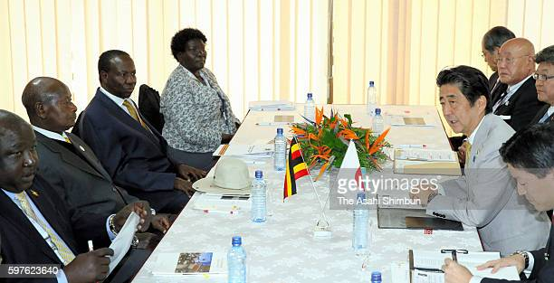 Japanese Prime Minister Shinzo Abe holds talks with Uganda President Yoweri Museveni on the sidelines of the Tokyo International Conference on...