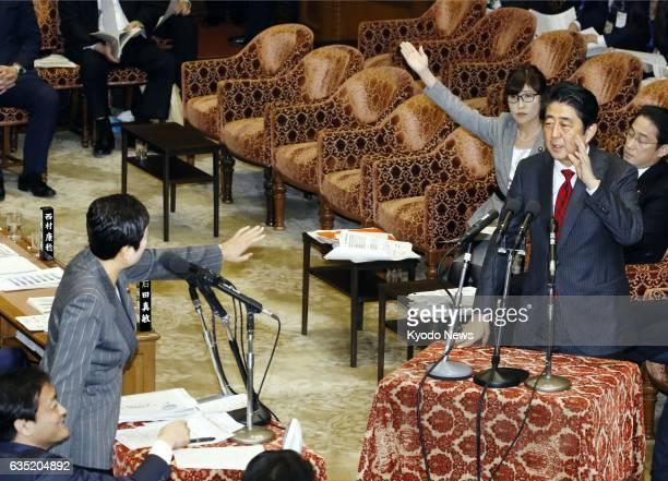 Japanese Prime Minister Shinzo Abe interrupts Democratic Party lawmaker Kiyomi Tsujimoto as she directs a question to Defense Minister Tomomi Inada...
