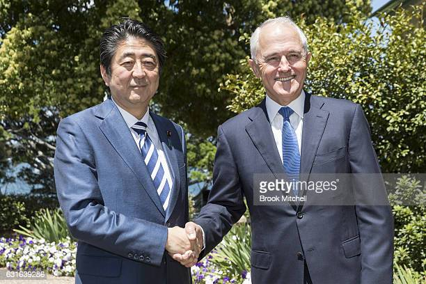 Japanese Prime Minister Shinzo Abe is greeted by the Australian Prime Minister Malcom Turnbull on arrival at Kirribilli House on January 14 2017 in...