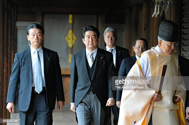 Japanese Prime Minister Shinzo Abe is seen during his visit to Yasukuni Shrine on December 26 2013 in Tokyo Japan It will likely inflame tensions...