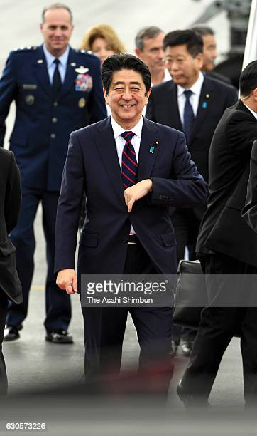 Japanese Prime Minister Shinzo Abe is seen on arrival at US Air Force Hickam Field on December 26 2016 in Honolulu Hawaii On December 27 Abe will...