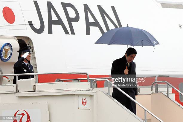 Japanese Prime Minister Shinzo Abe is seen on arrival at Yamaguchi Ube Airport ahead of the meeting with Russian President Vladimir Putin on December...