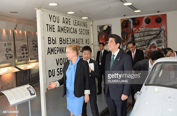 Japanese Prime Minister Shinzo Abe is shown around the Wall Museum at Checkpoint Charlie by museum's director Alexandra Hildebrandt in Berlin on...