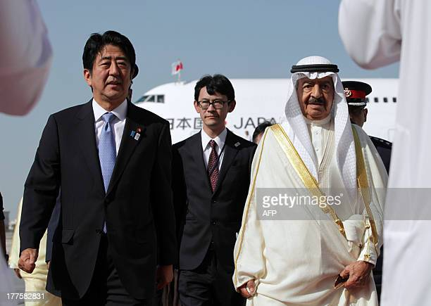 Japanese Prime Minister Shinzo Abe is welcomed by Bahraini Prime Minister Khalifa bin Salman alKhalifa upon his arrival at the Bahraini airport in...