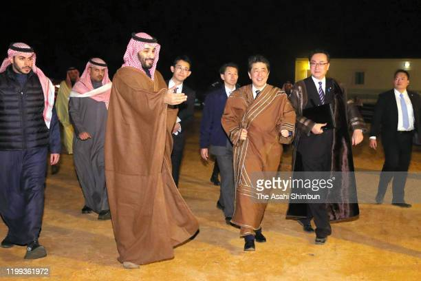 Japanese Prime Minister Shinzo Abe is welcomed by Crown Prince Mohammad bin Salman of Saudi Arabia talk during their meeting on January 12 2020 in...