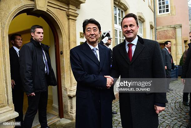 Japanese Prime Minister Shinzo Abe is welcomed by Luxembourg's Prime Minister Xavier Bettel at the start of his official visit to Luxembourg on...