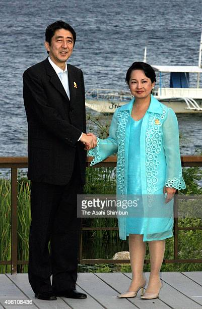 Japanese Prime Minister Shinzo Abe is welcomed by Philippines President Gloria Arroyo during the ASEAN - Japan Summit on January 14, 2007 in Cebu,...