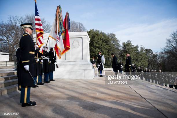 Japanese Prime Minister Shinzo Abe lays a wreath at the Tomb of the Unknown Soldier at Arlington National Cemetery in Arlington Virginia on February...