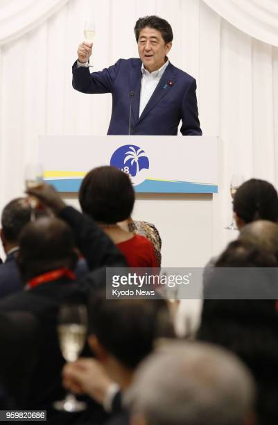 Japanese Prime Minister Shinzo Abe makes a toast at a banquet of the Pacific islands leaders' summit in Iwaki Fukushima Prefecture northern Japan on...