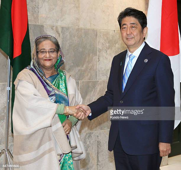Japanese Prime Minister Shinzo Abe meets with Bangladeshi Prime Minister Sheikh Hasina on July 15 on the sidelines of the AsiaEurope Meeting in Ulan...