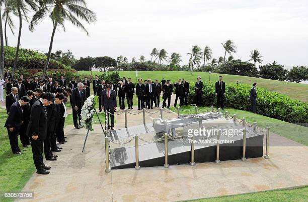 Japanese Prime Minister Shinzo Abe offers a wreath at a memorial for the victims of Ehime Maru a fisheries high school training ship which collided...