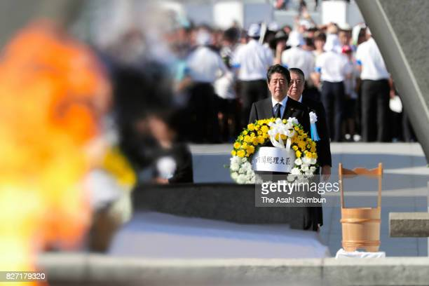 Japanese Prime Minister Shinzo abe offers a wreath during the peace memorial ceremony at the Hiroshima Peace Memorial Park on the 72nd anniversary of...