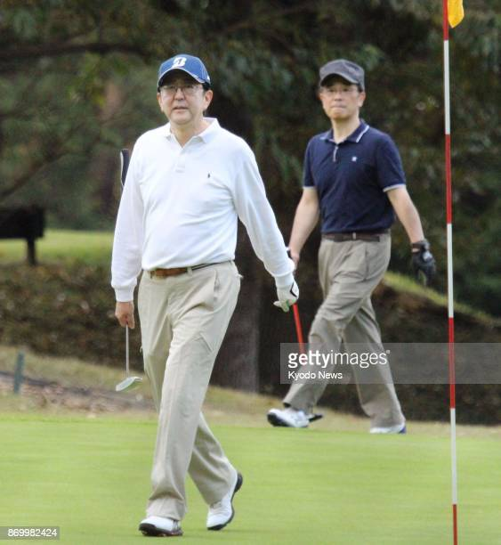 Japanese Prime Minister Shinzo Abe plays golf in Chigasaki Kanagawa Prefecture on Nov 3 2017 Abe played nine holes in about two hours the first time...