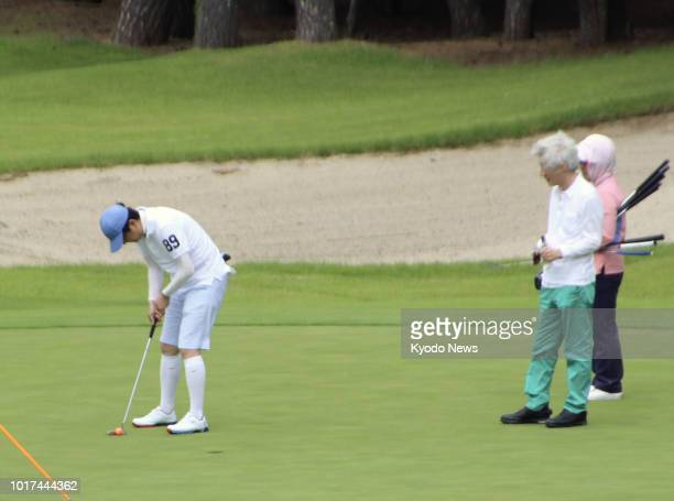 Japanese Prime Minister Shinzo Abe putts on a golf course in Fujikawaguchiko Yamanashi Prefecture during his summer vacation on Aug 16 as former...