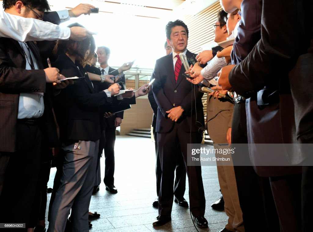 Japanese Prime Minister Shinzo Abe responds to questions from reporters after North Korea's missile launch at his official residence on May 29, 2017 in Tokyo, Japan.