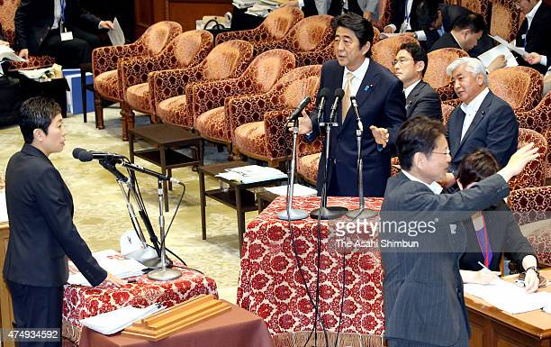 Japanese Prime Minister Shinzo Abe responds to the question by Democratic Party lawmaker Kiyomi Tsujimoto during a special committee to deliberate...