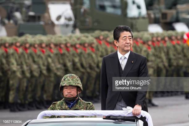 Japanese Prime Minister Shinzo Abe reviews troops of the country's Self Defense Forces during the annual review at the Japan Ground Self Defense...