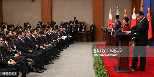 Japanese Prime Minister Shinzo Abe South Korean President Park Geunhye and Chinese Premier Li Keqiang attend a joint press conference after the...